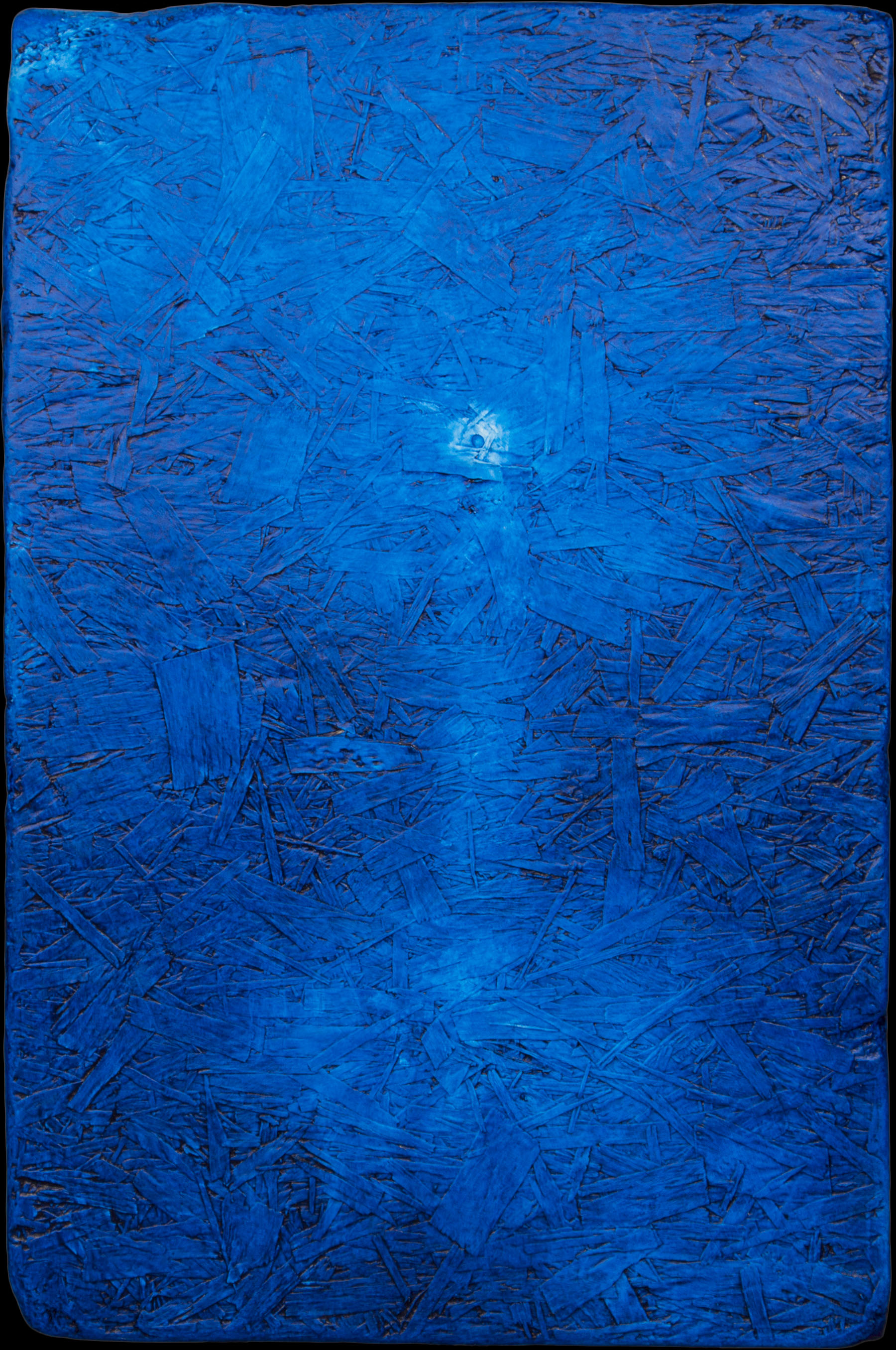 Blue paint on wood background