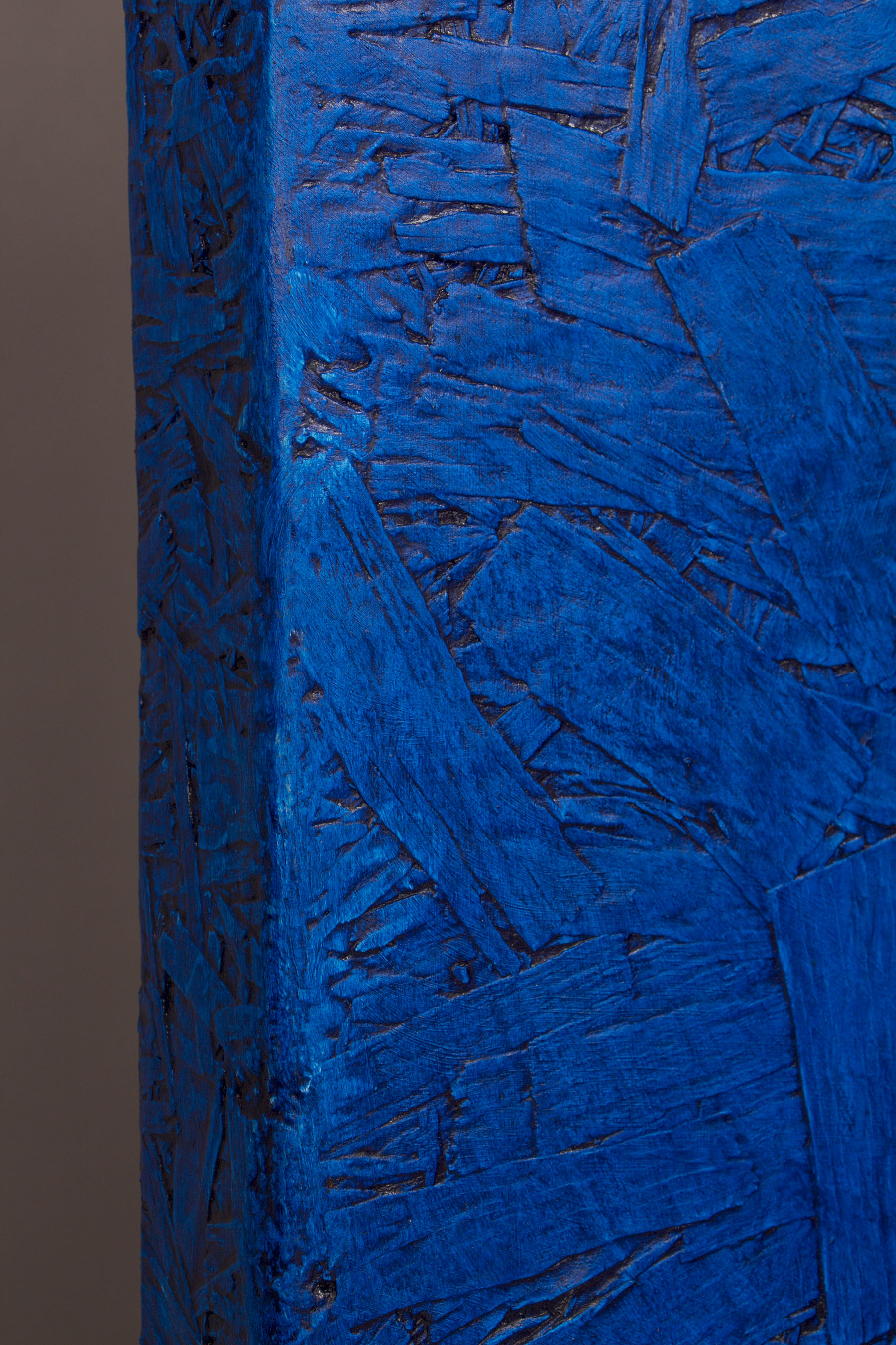 Blue paint on wood, detailed side view