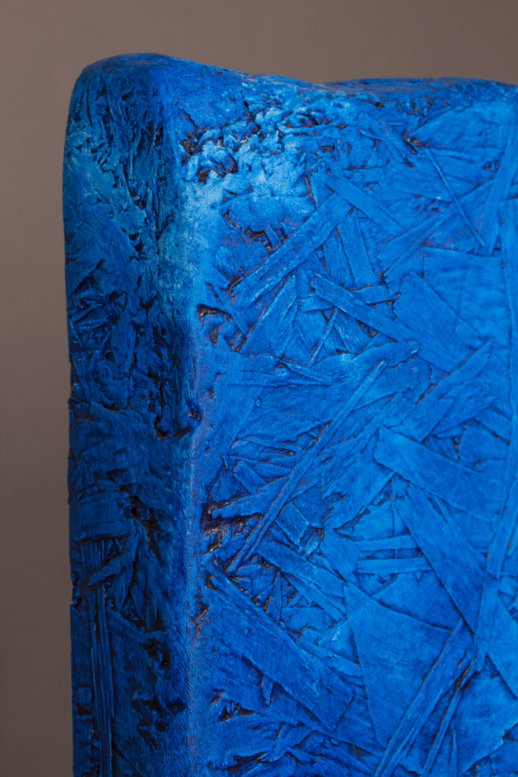 Top corner, side view, blue paint on wood